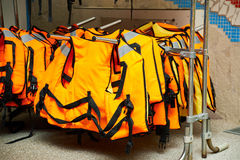 Life jacket hanging on hanger in store Royalty Free Stock Images