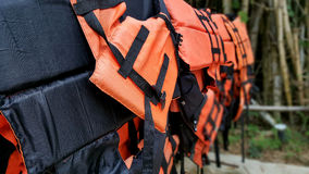 Life jacket. S hanging on hangers stock photos