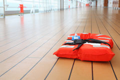 Life jacket lies on deck of cruise liner Royalty Free Stock Photography