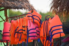 Life jacket. A life vest or life jacket is hung for drying out.A sleeveless jacket or vest that is filled with buoyant material and used as a life preserver Royalty Free Stock Photography