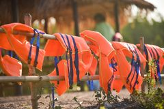 Life jacket. A life vest or life jacket is hung for drying out.A sleeveless jacket or vest that is filled with buoyant material and used as a life preserver Stock Photo