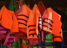Life jacket. A life vest or life jacket is hung for drying out.A sleeveless jacket or vest that is filled with buoyant material and used as a life preserver Royalty Free Stock Image