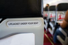 Life jacket under your seat sign, safety Royalty Free Stock Photo