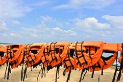 Life jackets. Orange life jackets at beach royalty free stock photos