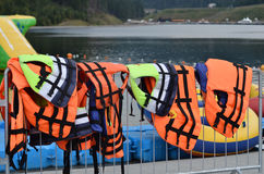 Life jackets. On the background water stock photos