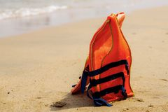 Life jackets on beach. Life jackets on the beach with sunlight royalty free stock image