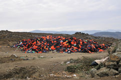 Life Jackets and boats left on Greek beach by refugees Royalty Free Stock Photo