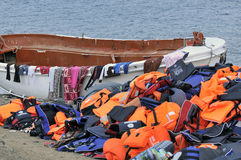 Life Jackets and boats left on Greek beach by refugees Royalty Free Stock Photography