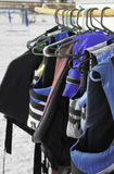 Life Jackets. Colorful life jackets hanging in a row at the beach stock photo
