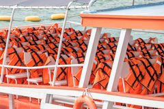 Life jackets on the deck of a cruise ship. Life vest ready for ferry passengers royalty free stock photography