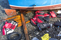 Life Jackets discarded on a beach. Refugees come from Turkey in an inflatable boat. Stock Photos