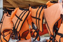 Life jackets. Dry under a wooden canopy close-up royalty free stock photography