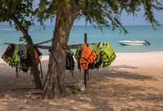 Life jackets. Drying on the beach Royalty Free Stock Photos