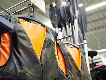 Life jackets for fishing in sport shop stock images