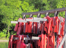 Life Jacket Rental. Life jackets hanging for rent at a favorite canoe and kayak rental site on the Meramec river in Missouri Stock Photography