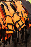 Life jackets hanging on the row. Royalty Free Stock Image
