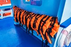 Life jackets on marine tourism boats. Sea, travel, summer, nature, orange, ocean, water, outdoors, bay, ship, tourist, landscape, safety, security, recreation royalty free stock photos