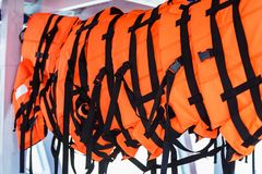 Life jackets on marine tourism boats. Sea, travel, summer, nature, orange, ocean, water, outdoors, bay, ship, tourist, landscape, safety, security, recreation royalty free stock photography