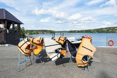 Life jackets on the shore of a picturesque place to relax. Safe boat trips.  stock photos