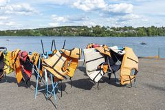 Life jackets on the shore of a picturesque vacation spot. Safe water rides.  royalty free stock image