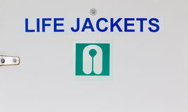 Life Jackets Sign on Door Stock Photos