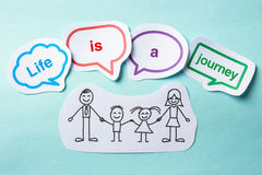 Life is a journey. Happy paper family with speech bubbles of Life is a journey concept on the blue background royalty free stock photography