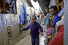 Daily life of Kenyan blind child in slum, Nairobi. Kenya, capital Nairobi: in the east of the city learns a blind boy slum to walk alone in a narrow corridor Royalty Free Stock Photography