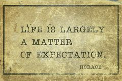 Life is largely Horace. Life is largely a matter of expectation -  ancient Roman poet Horace quote printed on grunge vintage cardboard stock image