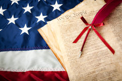 Life, Liberty and the pursuit of Happiness. The American flag, the US constitution and a fountain pen, can be used for 4th of july or any other patriotic Royalty Free Stock Images