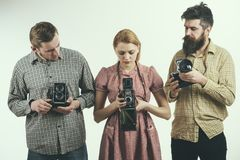 Life is like a camera. Retro style woman and men hold analog photo cameras. Group of photographers with retro cameras. Life is like a camera. Retro style women royalty free stock photo