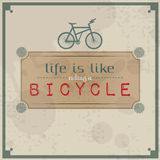 Life is like riding a bicycle. Vintage Typographic Background. Motivational Quote. Retro Label With Calligraphic Elements Royalty Free Stock Photo