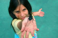 Life line. Pretty girl show the black bug on her hand ,crossing life line Royalty Free Stock Photography