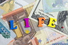 Life and money. Different money are on the table Royalty Free Stock Photography
