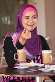 Life of muslim girl. Muslim girl at coffee table Royalty Free Stock Photography