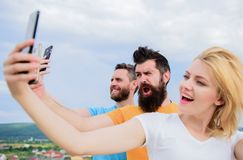 Life online. People taking selfie or streaming online video. Mobile internet and social networks. Mobile dependency. Problem. Girl and men with mobile royalty free stock photo