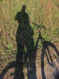 Life on the other side. Shadows, sun, travel, cycling, summer, pleasure, hobbies, rest royalty free stock photo