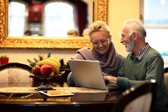 Life partners searching and exploring the internet. Using their new laptop royalty free stock images