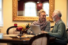 Life partners searching and exploring the internet. Using their new laptop royalty free stock photography