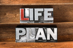 Life plan tray. Life plan phrase made from metallic letterpress type on wooden tray Stock Image