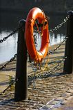 Life Preserver 02. A life-preserver or life-belt on a stand by the docks in Liverpool Stock Photos
