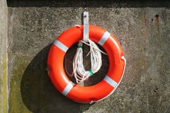 Life Preserver 1. A life preserver without text hanging on a concrete wall Stock Image