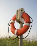 Life preserver. Hanging on post on beach on Bald Head Island, North Carolina Royalty Free Stock Photography
