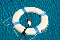 Life Preserver. Floating in a Swimming Pool stock photos