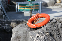 Life preserver. Red life buoy to the rescue Stock Image