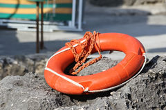 Life preserver. Red life buoy to the rescue Royalty Free Stock Photo