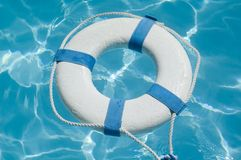 Life preserver. Life ring floating on top of beautiful blue water Stock Photography