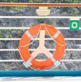 Life Preserver. Attached to the railing of a ship Stock Image