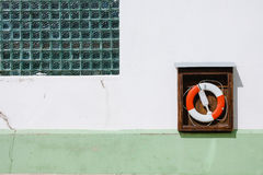 Life preserver. Attached to a wall Royalty Free Stock Photo