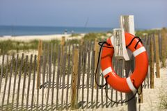 Life preserver on beach  Royalty Free Stock Images