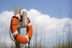 Life preserver on beach. Life preserver hanging on post on beach on Bald Head Island, North Carolina Stock Photography